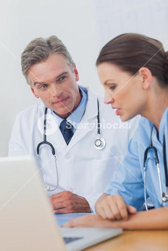 Doctor listening attentively to a colleague