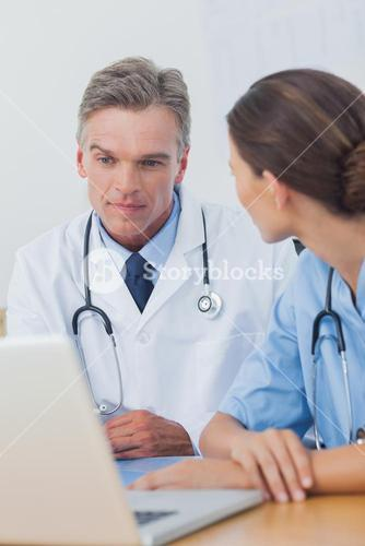 Doctor listening to a colleague