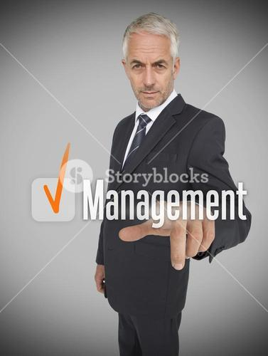 Businessman selecting the word management
