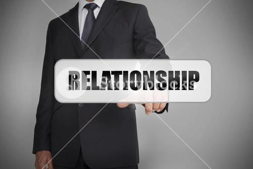 Businessman selecting the word relationship