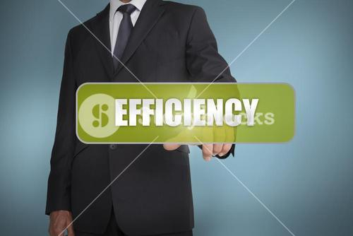 Businessman selecting the word efficiency
