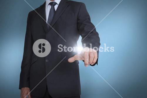 Businessman pressing something