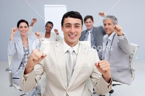 Happy business team celebrating a sucess