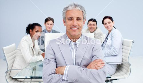 Mature businessman smiling in a meeting