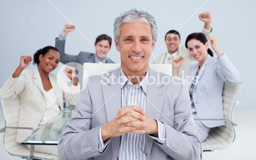 Happy manager and business team celebrating a sucess