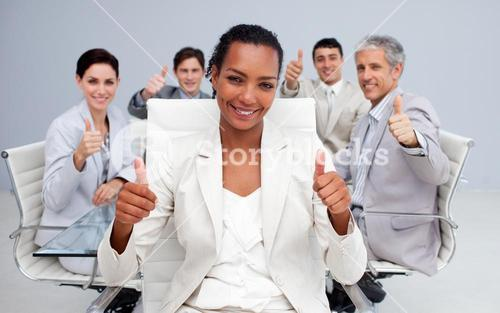 Businesswoman and her team with thumbs up