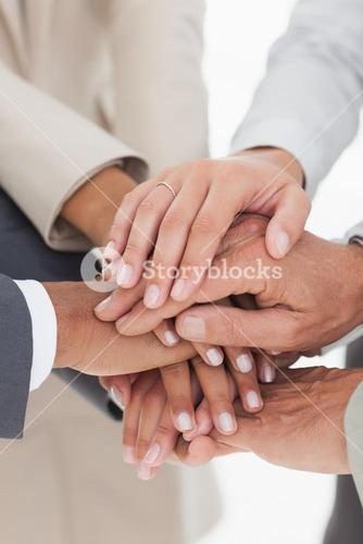 Business teams hands together