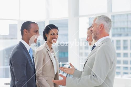Happy business team chatting