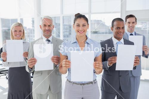Business team showing blank pages