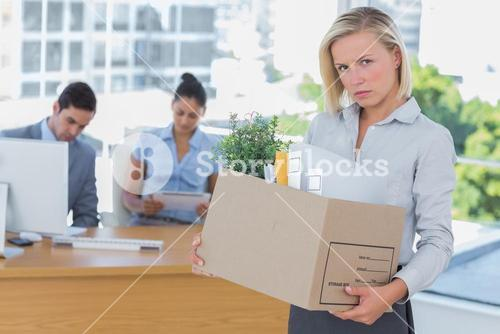 Upset businesswoman leaving office after being let go