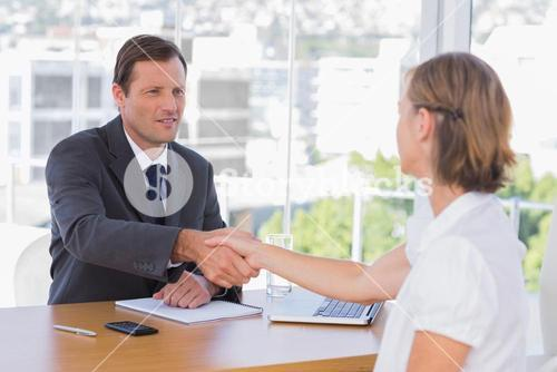 Businessman shaking hand of a job applicant