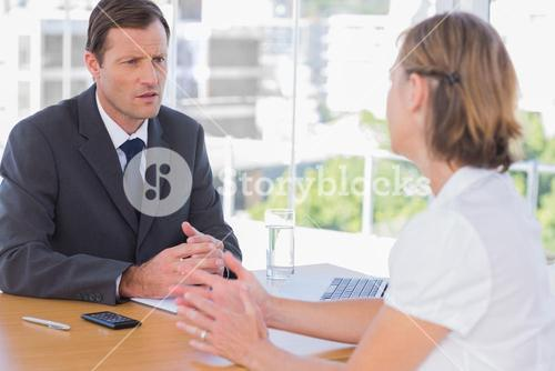 Businessman having a discussion with a job applicant