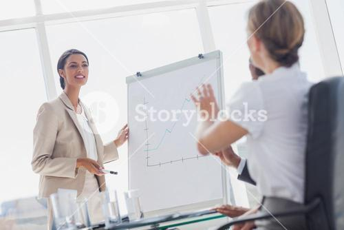 Businesswoman asking a question to a colleague