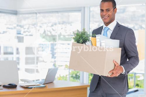 Smiling businessman leaving his company