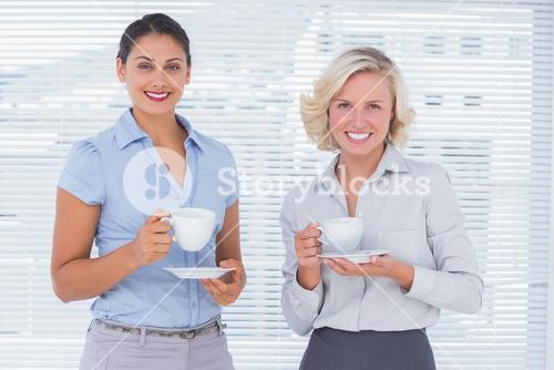 Cheerful coworkers smiling