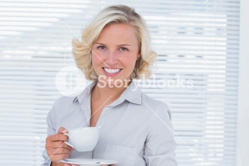 Businesswoman holding a cup