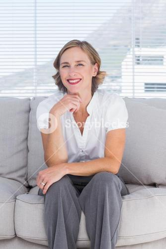 Confident businesswoman sitting on couch