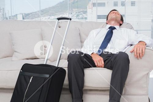 Businessman napping on couch