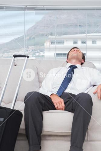 Exhausted businessman sleeping