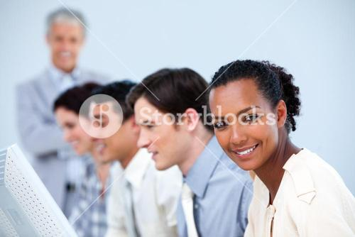Confident business people with their senior manager