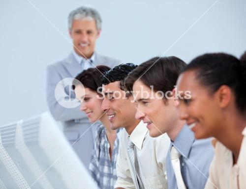Positive business people with their senior manager