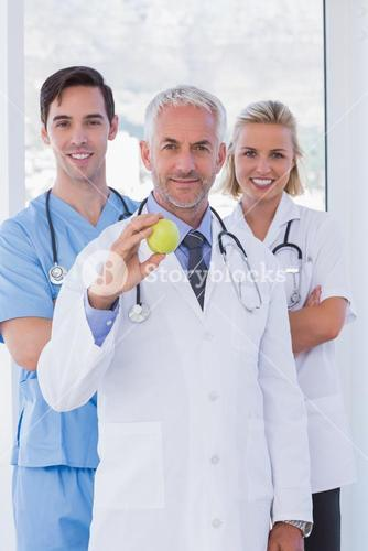Cheerful medical staff standing together