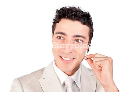 Positive businessman with headset on