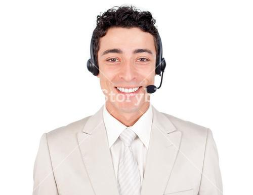 Confident young businessman with headset on