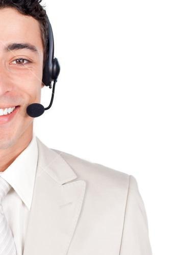 Close up of a smiling businessman with headset on