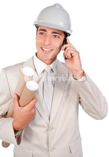 Positive male architect talking on phone