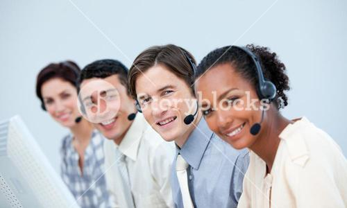 Smiling business people using headset
