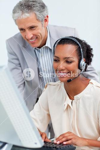 Diverse business partners working at a computer