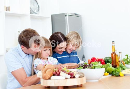 Jolly young family cooking together