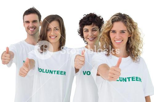 Group of volunteers giving thumbs up