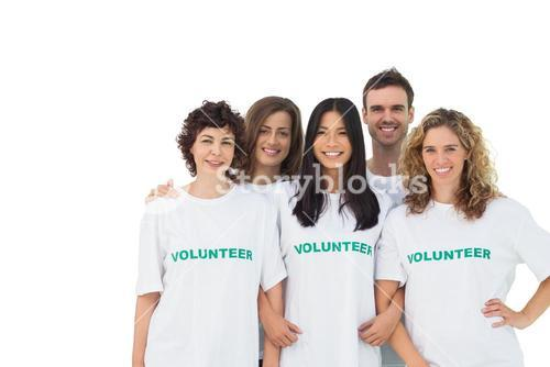 Smiling group of volunteers standing