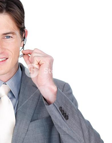 Close up of a businessman talking on a headset