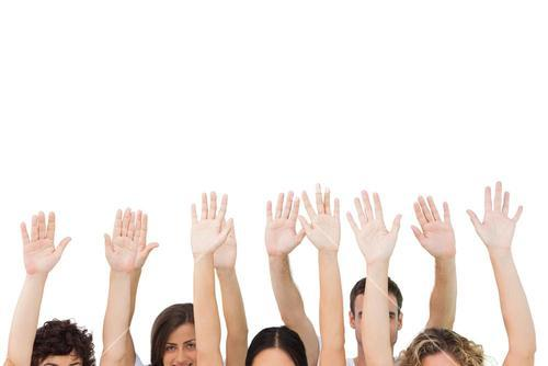 Group of people raising arms
