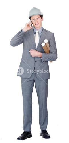 Assertive male architect talking on phone standing