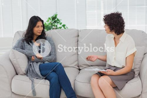 Woman listening to her therapist