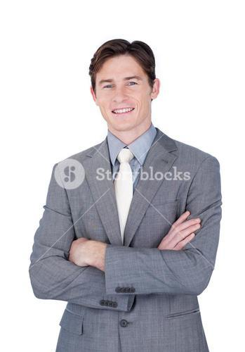 Selfassured businessman standing with folded arms
