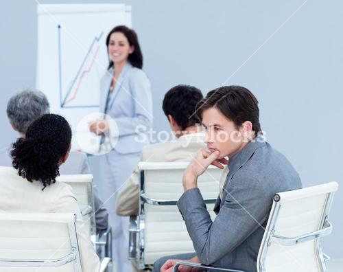 Bored young businessman at a presentation