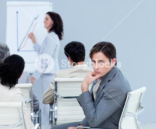 Bored charming businessman at a presentation