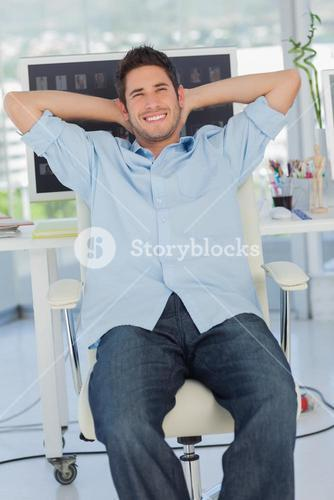Cheerful creative business employee relaxing