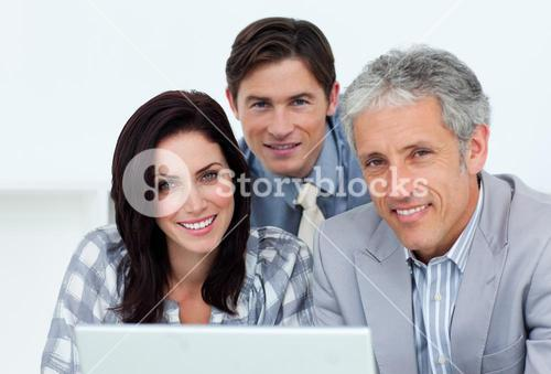 Charismatic business people working at a computer