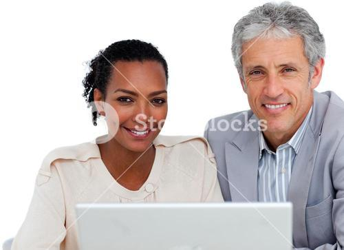Diverse business people working at a computer