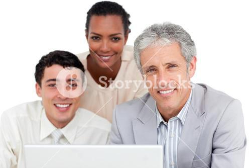 Charismatic business coworkers using a laptop