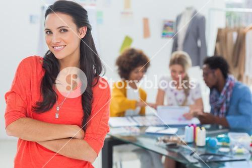 Smiling fashion designer with arms crossed
