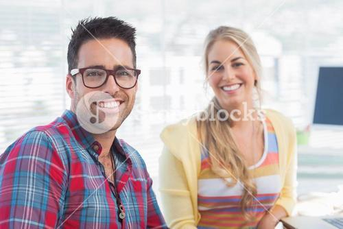 Attractive designers sit in their office