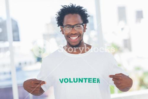 Handsome man pointing to his volunteer tshirt