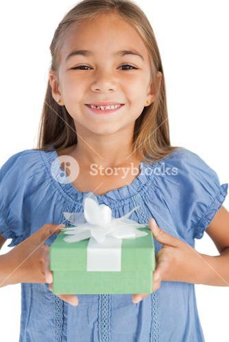 Cheerful little girl holding a wrapped gift